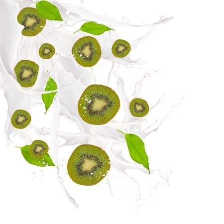 Kiwi and leaf in milk splash, isolated on white background  photo