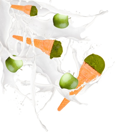 Green ice creams with cone into milk splash on white background  photo