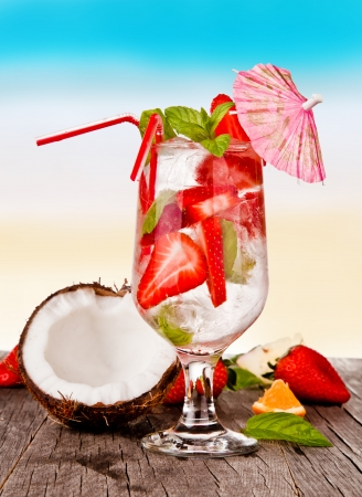 Summer drinks with blur beach on background  Stock Photo - 19448081