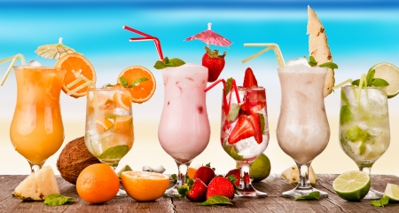 alcoholic drinks: Summer drinks with blur beach on background