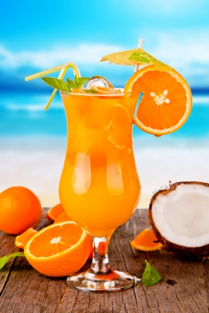 Summer drink with blur beach on background Stock Photo - 19448083