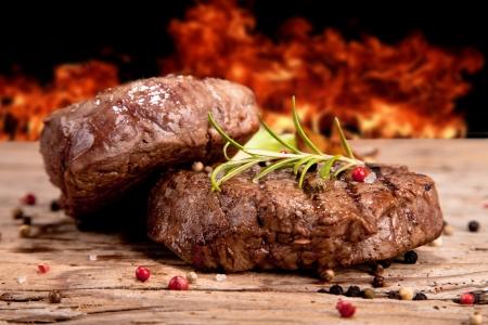 Grilled steaks on wood