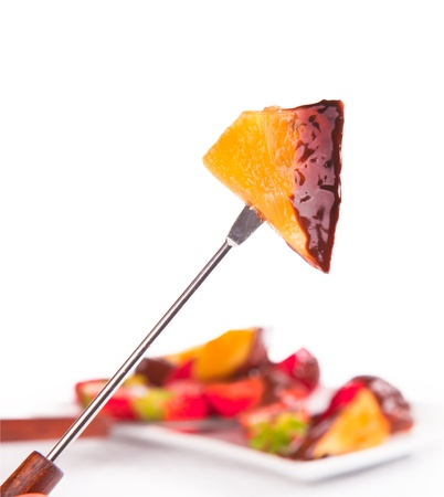 pineapple dipped in chocolate fondue  photo