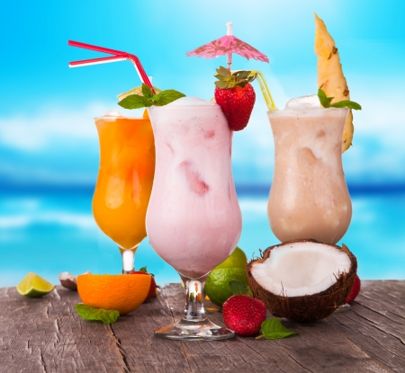 Summer drinks with blur beach on background  photo