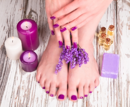 Beautiful woman Hands and sole. Manicure concept Stock Photo