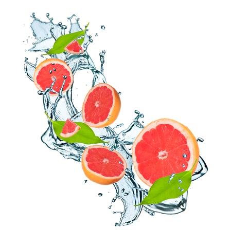 Fresh grapefruit falling in water splash