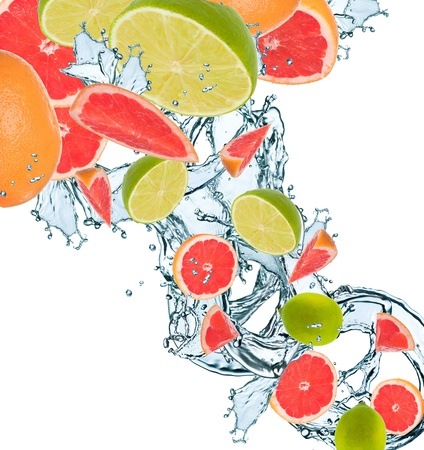 Fresh citrus falling in water splash photo
