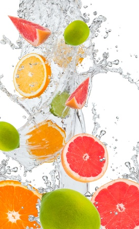 Fresh oranges, lime amd grapefruits falling in water splash, isolated on white background