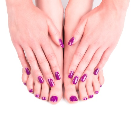 nail care: Beautiful woman Hands and sole. Manicure concep  Stock Photo