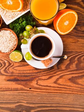 Breakfast including coffee, carrot,orange juice, muesli and fruits  photo