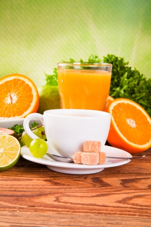 Breakfast including coffee, carrot,orange juice, muesli and fruits  photo