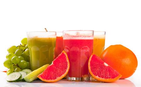 Fresh fruits, vegetables and juice isolated on white background  photo