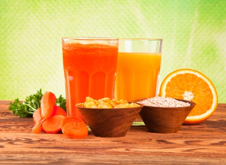 Fresh fruits, vegetables and juice on wood  photo