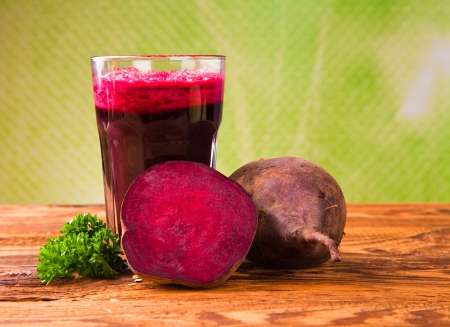 beet: Beetroot juice,Healthy drink on wood