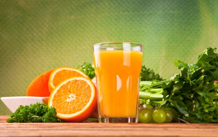 Fresh fruits, vegetables and juice isolated on wood  photo