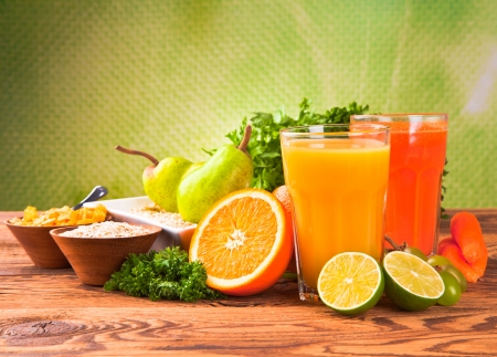 Fresh fruits, vegetables and juice isolated on wood