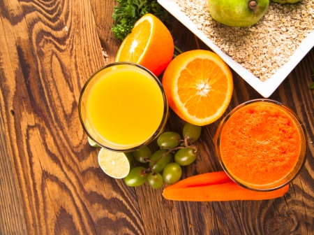 Fresh vegetable and fruits juices on wood  photo