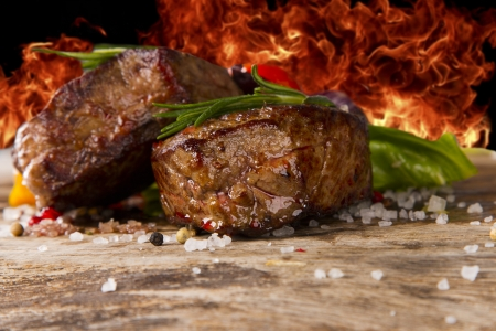 Grilled steaks on wood