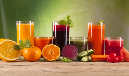 green and purple vegetables: fresh juice on wood Stock Photo