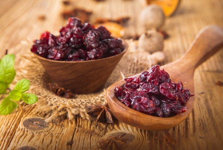 Cranberries fruits on wooden table photo