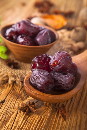 Dates fruit on a wooden table Stock Photo