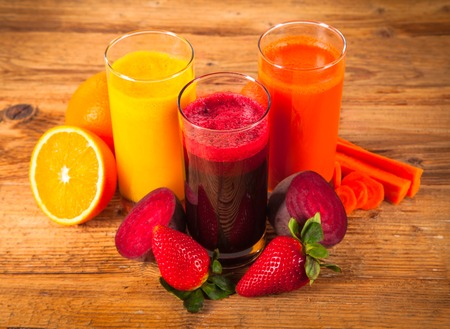 fresh juice on wooden table photo