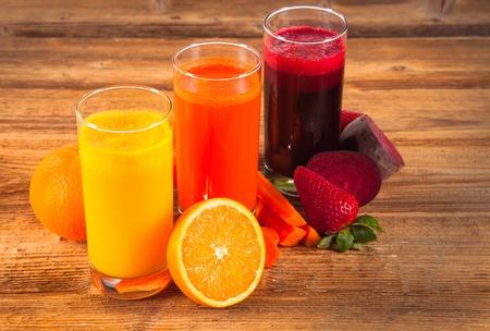 fresh juice and fruits on wood plant photo