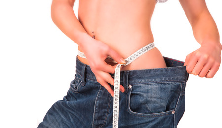 Diet concept  Woman measuring her waist, isolated Stock Photo