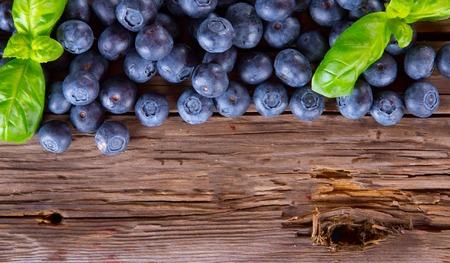 fruit bowl: Fresh blueberry on wooden table  Garden fruits  Organic Stock Photo