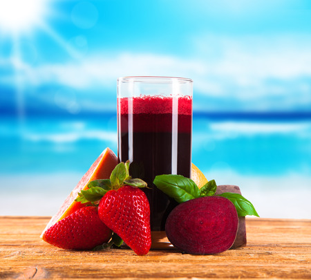 Beetroot juice,Healthy drink on wooden background with vegetable and blue sky  photo