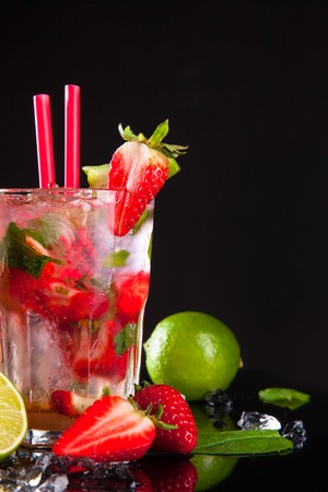 Summer strawberry cocktail , drink with fresh fruits on black stone  photo