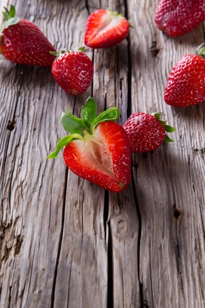 Fresh berries on wood background, strawberry fruits, wooden table  photo