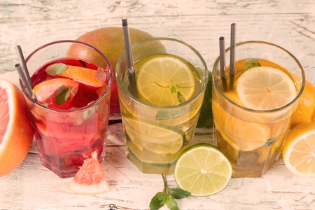 Summer drinks on wooden table  Ice team with fruits  photo