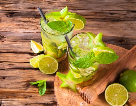 Summer lime cocktail , drink with fresh fruits on wooden table