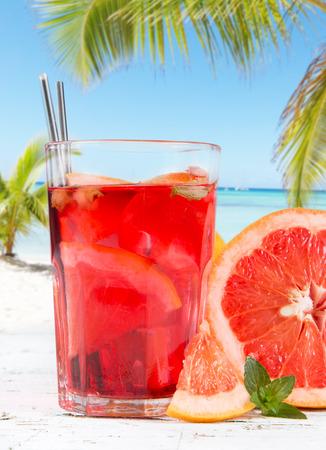 Grapefruits slice, mint ice tea on wooden background  Refresh drink