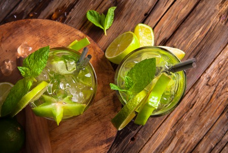 juice bar: Mojito drink on wood with blur beach background  Stock Photo