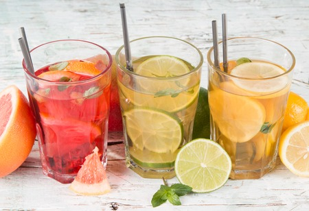Lemon,lime and grapefruits slice, mint ice tea on wooden background  Refresh drink