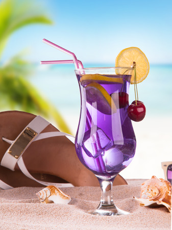 Summer concept, sandy, tropical beach,sandals and summer drink photo