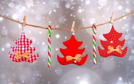 textil: Christmas textil decoration on line with abstract background. Stock Photo