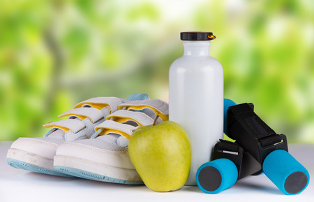sports activities: set for sports activities with nature green background Stock Photo