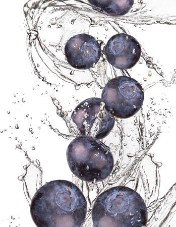 leaf water drop: Blueberries with watter splash isolated on white background