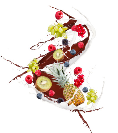Fruit mix, pineapple, kiwi, currant, blackberry, blueberry, raspberry, cherry in milk splash, isolated on white background Stock Photo