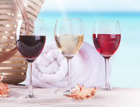wine on sand and summer accessories, Summer concept Stock Photo