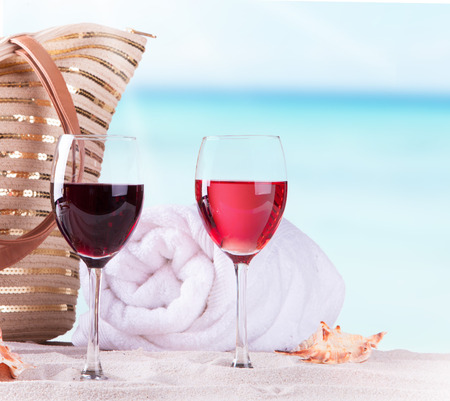 still life of wine: wine on sand and summer accessories, Summer concept Stock Photo