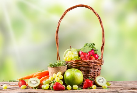 fresh fruits and vegetables on wooden table