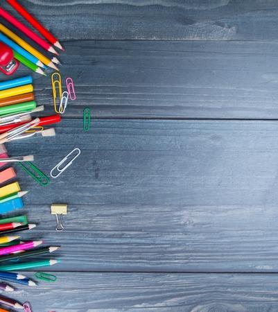 School supplies on blackboard background, back to school concept Stock Photo