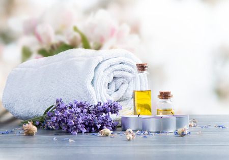 beauty product: spa massage setting, lavender product, oil on wooden