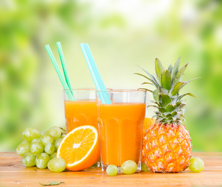 multivitamin: Fresh juice, orange and multivitamin on wooden table