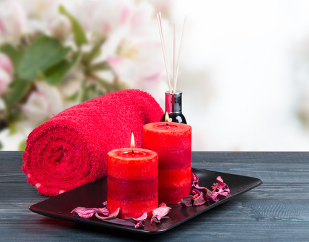 blosom: spa massage setting, rose product, oil on wooden