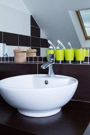 to sink: Sink and Reflection in Modern Bathroom
